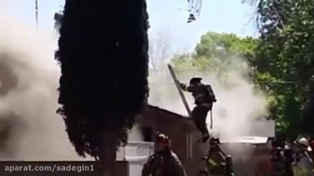 Firefighter falls through burning roof in Fresno CA