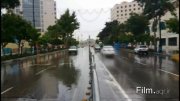 هدیه بهار... لحظات بارانی در حرم رضوی