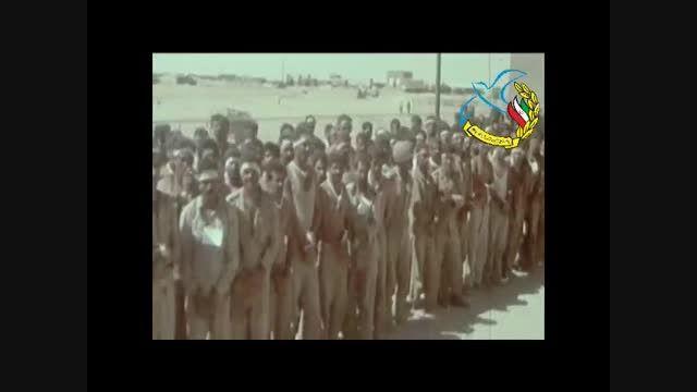رژه اسرا عراقی در مقابل فرماندهان ارتش و سپاه