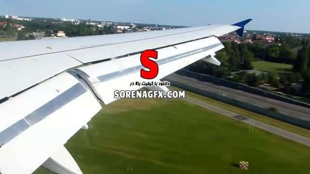 دانلود فوتیج فرود هواپیما بر روی باند از نمای داخل هواپ