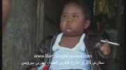 کودکی در اندونزی که روزی ۲ بسته سیگار می