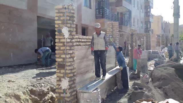 سنگ کردن دیوار حیاط
