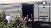 انتقال اجساد سرنشینان هواپیمای مالزی به مقصد نامعلوم