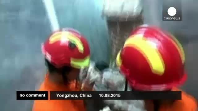 نجات کودک چینی از میان دیوار بتونی