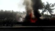 آتش گرفتن کامیون حامل بشکه های نفت