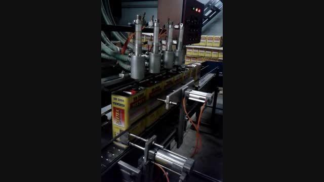 دستگاه پرکن روغن 4 لیتری عینیان ماشین 09121256100