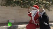 بابانوئل فلسطینی و سربازان اسرائیلی
