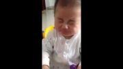 عکس العمل بچه بعد خوردن لیموترش