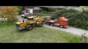 ساخت سد به کمک تریلی و لودر کنترلی
