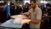 پخت نان همراه پذیرایی از زائران اربعین در عراق/دانسفهان