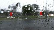 دانلود فوتیج بارش باران بر روی شیشه