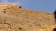 بردن علم هادر روز عاشورا به مزار نور روستای گیت