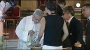 نخستین مراسم غسل تعمید فرزندخوانده یک زوج همجنس در آرژ