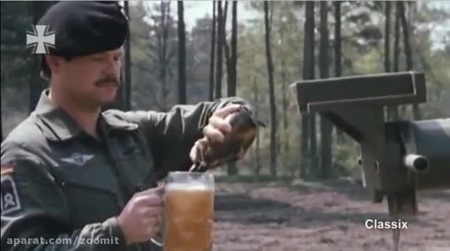 حمل لیوان پراز نوشیدنی روی لوله توپ تانک - زومیت