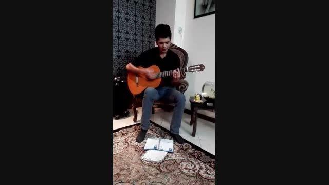 گیتار-رو درو دیوار این شهر