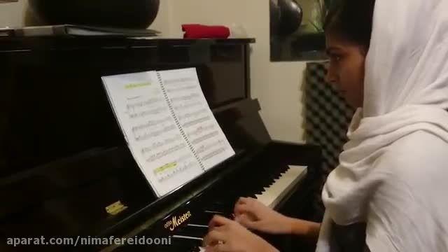 نگارقهرمانی،تمرین پیانو،هنرجوی متوسطه هامان بریمانی،کوچ