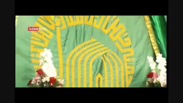مراسم تعویض پرچم گنبد امام رضا (ع)