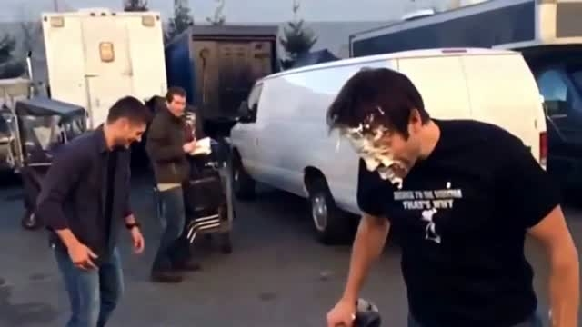 Jensen Ackles hits Misha Collins with a pie in the face