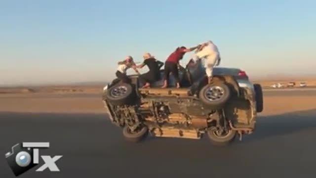راندن ماشین روی دو چرخ و باز کردن چرخ ها رو هوا!!!