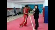شکستن چوب توسط دختر ایرانی رزمی کار