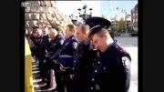 پاشیدن آب مقدس به پلیس
