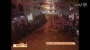 تعویض پرچم گنبد امام حسین علیه السلام در شب اول محرم
