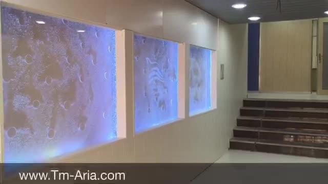طراحی و اجرای آبنمای شیشه ای حبابدار، آبنمای دیواری حبابی، آبنمای مدرن حبابی در دفتر هواپیمایی