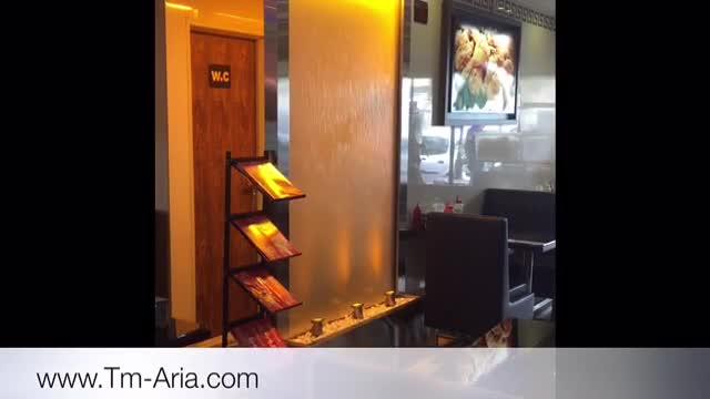 آبنما شیشه ای-دیوار شیشه ای متحرک-آبشار شیشه ای در فضای رستوران